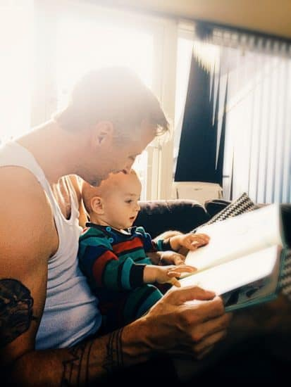 dad reading story to baby to help get ready for bed time