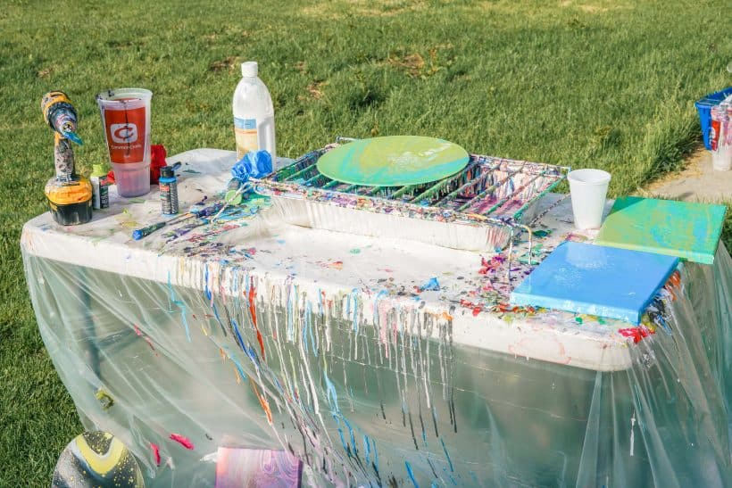 table set up with flow painting supplies