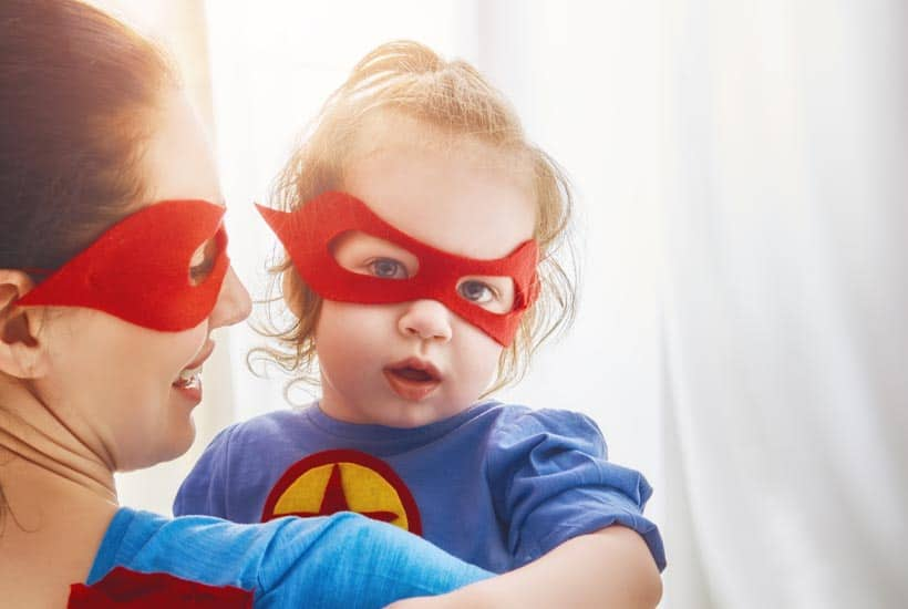 picture of strong baby girl with superman mask on